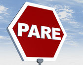 Road sign with stop in portuguese — Stock Photo