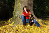 Young woman in autumn park — Stock Photo