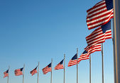 US flags near Washington Monument — Stock Photo