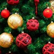 Christmas balls on Christmas tree — Stock Photo