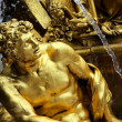Fragment of fountain in park of Versailles - Stock Photo