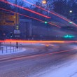 Street traffic in snowstorm — Stock Photo