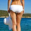 Young woman in white bikini - Stock Photo