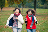 Two pretty girls in the park — Stockfoto
