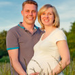 Pregnant couple in the park — Stock Photo #6222361