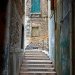 Stockfoto: Narrow street in Venice