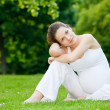 Beautiful pregnant woman in the park — Stock Photo #6445737