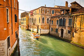 Canal in Venice illuminated by sunlight — Stock Photo