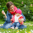 Foto Stock: Mother with baby in the park
