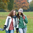 Two pretty girls having fun in autumn park — Stock Photo #6685433