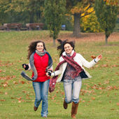 Two pretty girls having fun in a park — Stok fotoğraf