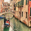 Gondola on canal in Venice - Stock Photo