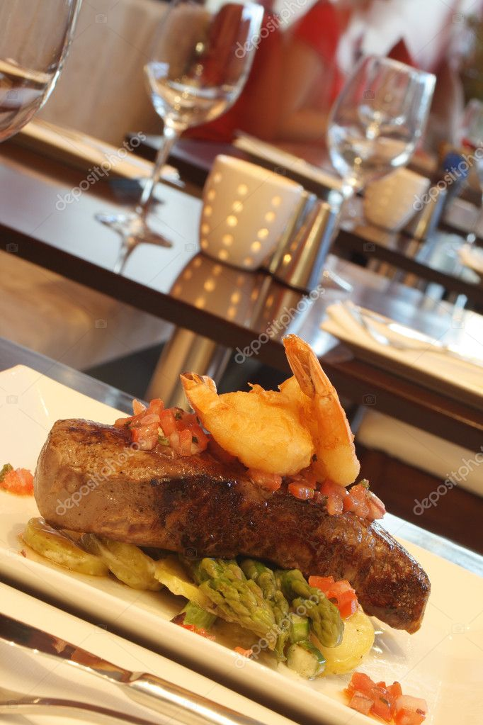 Steak and prawn surf and turf on a restaurant table. — Stock Photo #6078251