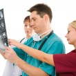 Three doctors with x-ray tomogram — Stock Photo
