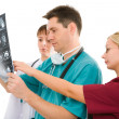 Royalty-Free Stock Photo: Three doctors with x-ray tomogram