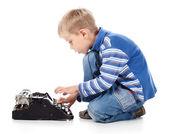 Boy typing on old typewriter — Stock Photo