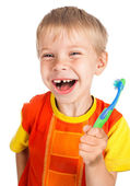 Left-handed smiley boy with toothbrush — Stock Photo