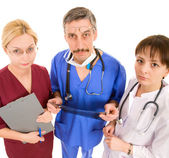 Comic doctor with his team — Stockfoto