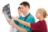 Three doctors with x-ray tomogram — Stock Photo