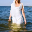 Bride in the river — Stock Photo