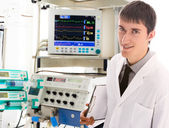 Young doctor in ICU — Stock Photo
