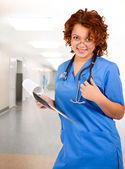 Young smiley female doctor — Stock Photo