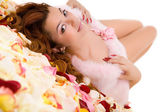 Young beauty woman lying on petal — Stock Photo