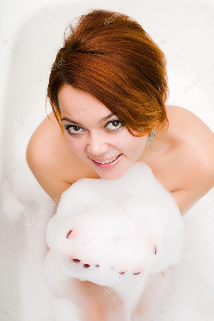 Young smiley naked woman in bathtub with soapsuds in hands  Stock Photo #6010216