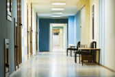 Reception in hospital with corridor — Stock Photo