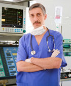 Experienced physician in ICU — Stock Photo