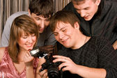Young men with photocamera — Stock Photo