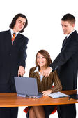 Smiling business team with laptop — Stock Photo