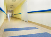 Long yellow corridor in hospital — Stock Photo