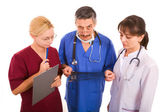 Suspicious doctor with his team — Foto Stock