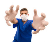 Funny doctor with long hands — Stock Photo