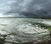 Floating ice under dark clouds — Stock Photo