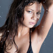 Royalty-Free Stock Photo: Young brunette woman with water droplets