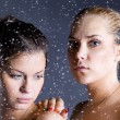 Two young beautiful woman with water droplets — Stock Photo