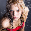 Young expressive beauty woman with water droplets — Stock Photo
