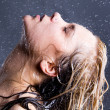 Royalty-Free Stock Photo: Blonde woman with falling water droplets