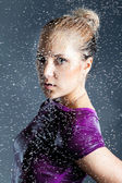 Young blonde woman in water splashes — Stock Photo