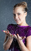 Youngwoman with falling water droplets — Stock Photo