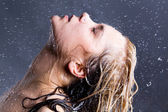 Blonde woman with falling water droplets — Stock Photo