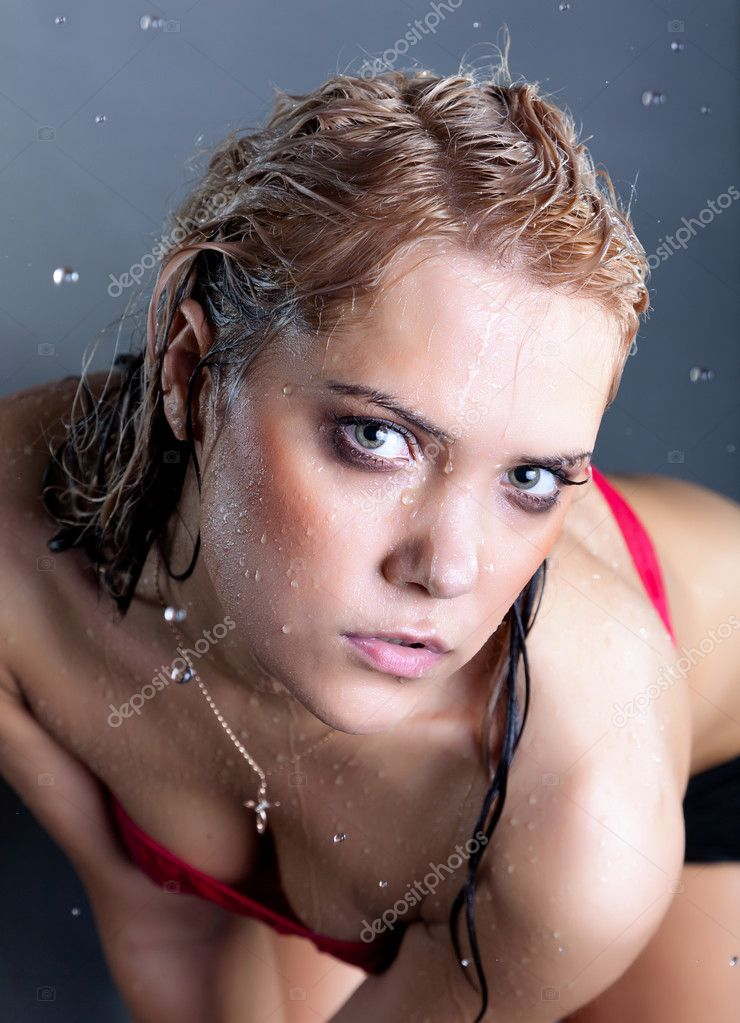 Young wet beautiful sensual blonde woman at black background — Stock Photo #6706569