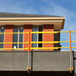 Stock Photo: Bright scaffolds on new house