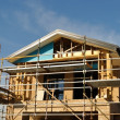 House front in scaffolds - Stock Photo