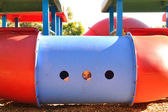 Smiling face in playground — Stock Photo