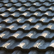 Black roof tiles in side light — Stock Photo #5915332