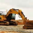 Stock Photo: Excavator in red soil