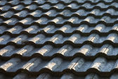 Black roof tiles in side light — Stock Photo